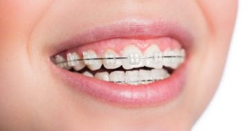 What is the best age to achieve healthy jaw growth with orthodontic treatment?